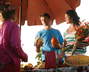 Learning about locally grown fruits and vegetables at the Kapaa Farmers Market
